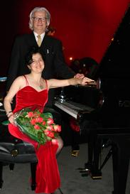 Ms. Gutman by Fazioli Grand Piano after premiere of her new composition at the Conference'2005 of the Pacific Voice and Speech Foundation at Pixar, with the Founder  Krzysztof Izdebski, Assoc. Professor of Stanford University