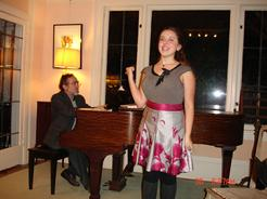 Charlotte Khuner (accompanied by Jonathan Khuner) performing at the Children Holiday Musicale at the Arts House of Becky and Mike O'Malley, organized by Eliza O'Malley, Dec. 2011