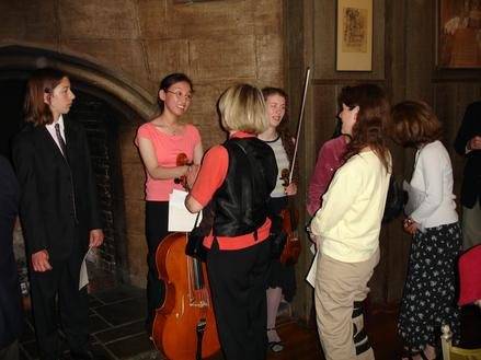 At the YAA Winners Reception at the Etude Club of Berkeley, CA, USA, May 2005.  Preben Antonsen (left) is the 1st Prize winner of the newly established Original Composition Award.  Etude Club members and their guests are greeting the Awards Winners.